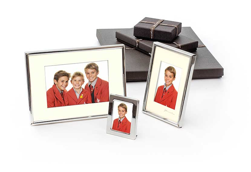Photograph of 3 silver plated frames