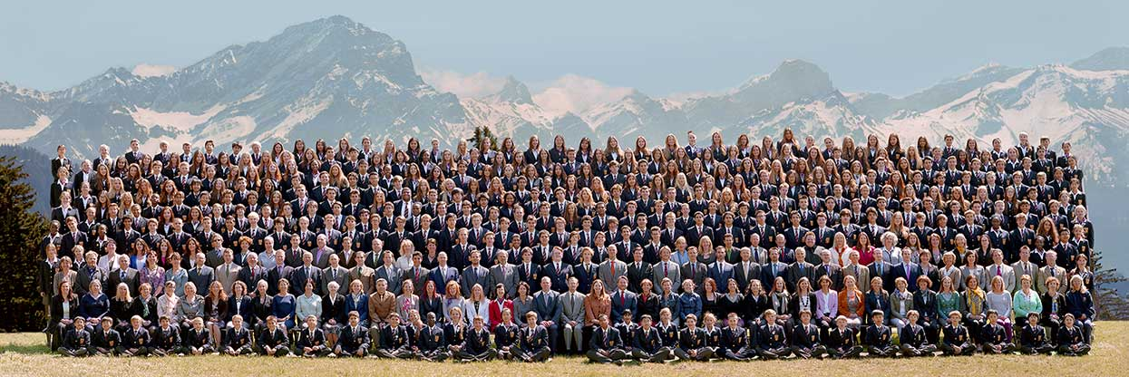School photograph in Switzerland, with the mountains in the background.